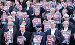 Lawyers protest outside Birmingham crown court during a half-day walkout against legal aid cuts